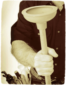 Close-up of a plumber's arm as he holds a plunger