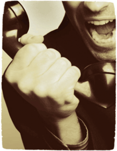 A man yelling into an old-fashioned phone