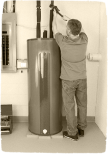 A plumber fixing a water tank