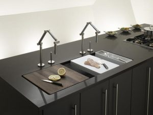 Two very modern Kohler sinks with cutting boards