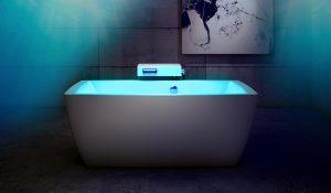 Freestanding bathtub, Quebec-made BainUltra, lit with a blue light