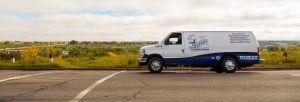 Instant Plumbing service van on the road