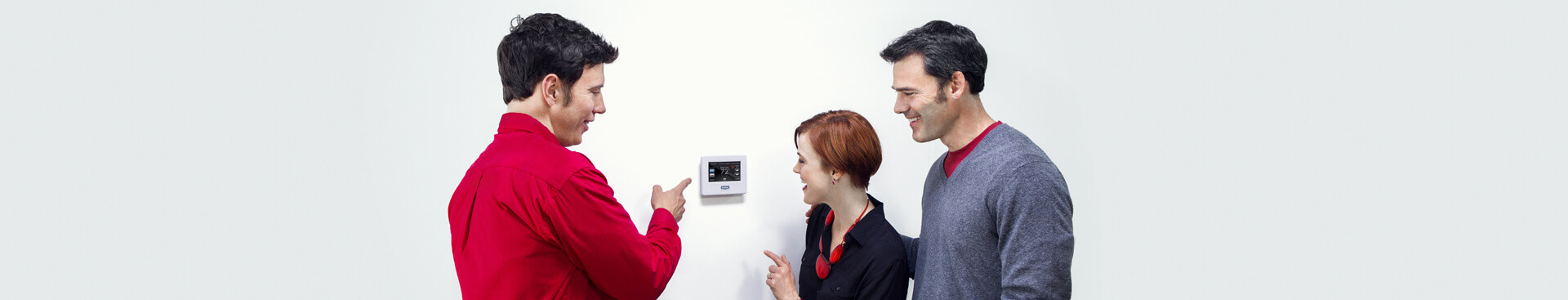 Technician and homeowners discussing a home automation system
