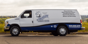 An Instant Plumbing service van on the road