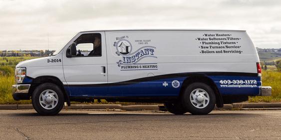 An Instant Plumbing service van on the road