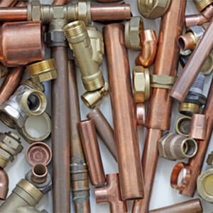 A pile of various pipes and valves
