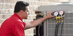 Man performing diagnostics on an outdoor air conditioning unit