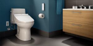 modern, dark blue bathroom featuring a white ceramic toilet